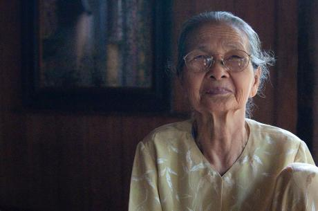 A portrait of an older Asian woman