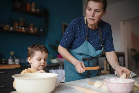 A woman and her grandson baking at home