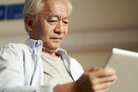 Older man looking at a tablet