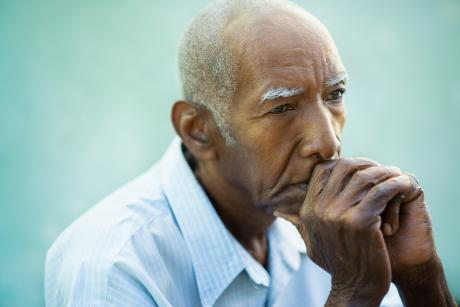 Portrait of contemplative older Black man
