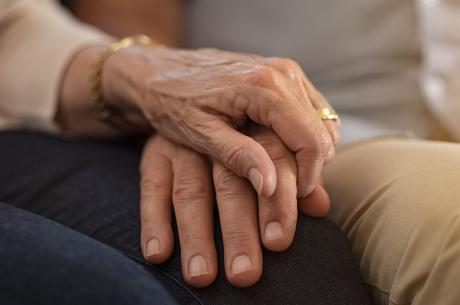 close of of couple holding hands