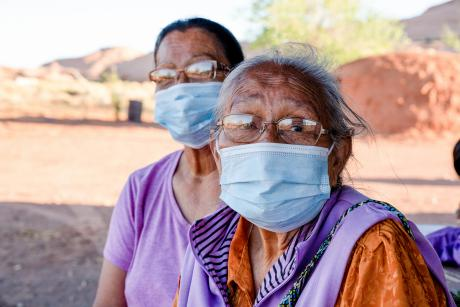 Two older Navajo women wearing masks are at high risk of contracting the Covid19 virus, Monument Valley, Navajo Nation Territory
